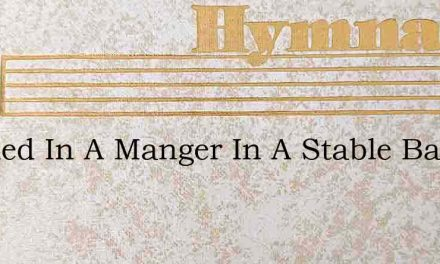 Cradled In A Manger In A Stable Bare – Hymn Lyrics